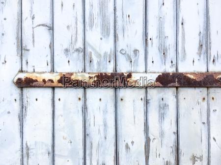 old door with rusty door hinge