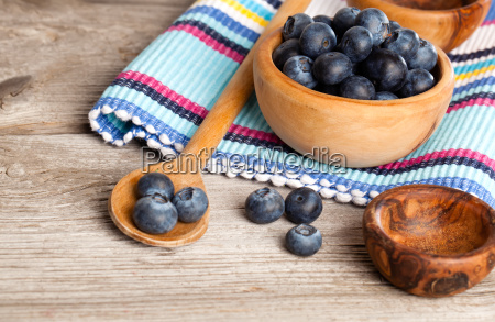 blueberry on rustic wooden table healthy