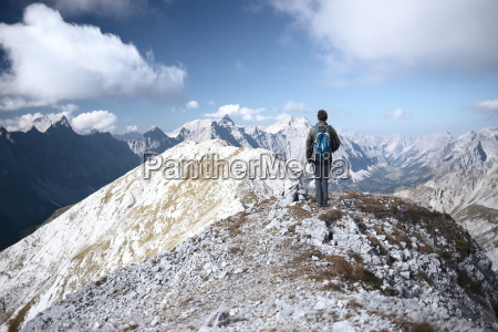 climber stands at the summit