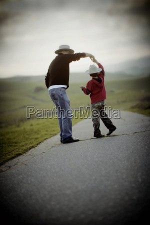 portrait of father and son dancing