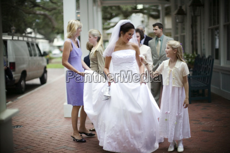 young flower girl giving a flower