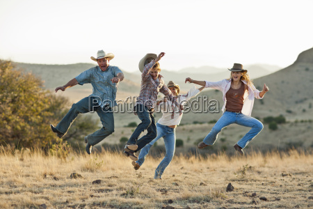 playful family leaping in the air