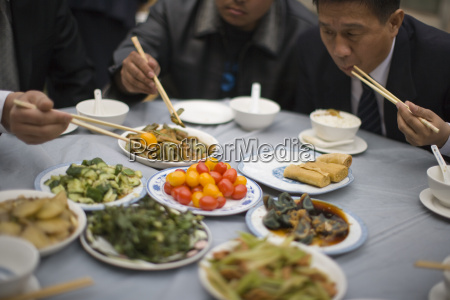 food being eaten with chopsticks by