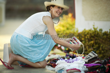 a woman smiles while purchasing a