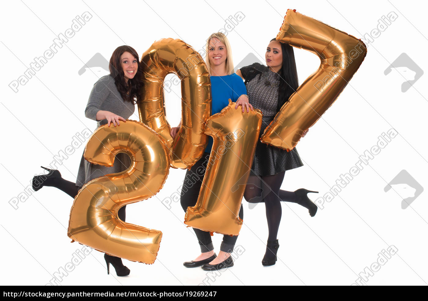 three, women, hold, golden, numbers, at - 19269247