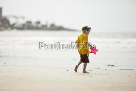 preschool age boy playing at the