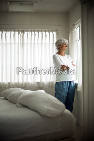 unhappy mature woman in her pajamas