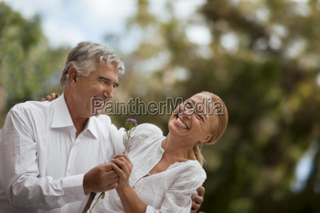 woman laughs as she accepts a