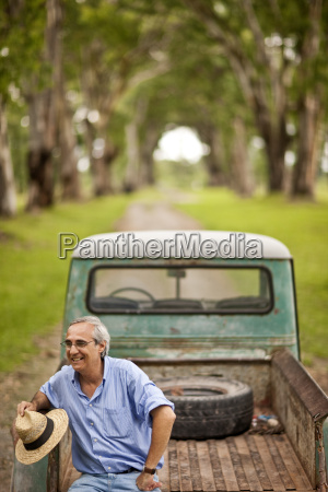 mature man happily sitting on the