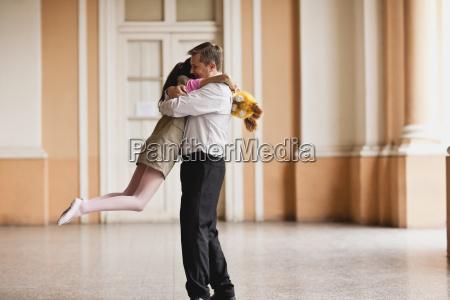 man happily hugging his daughter