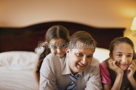 two girls and their father relaxing