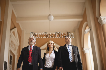 three colleagues walking together