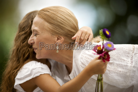 young girl holding small bunch of