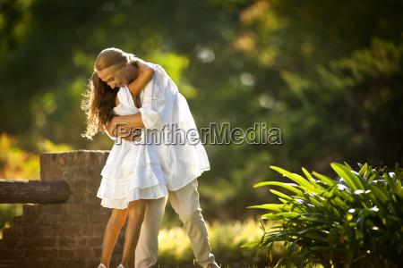 mature woman lovingly hugging her granddaughter