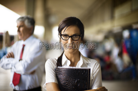 businesswoman and man waiting at train