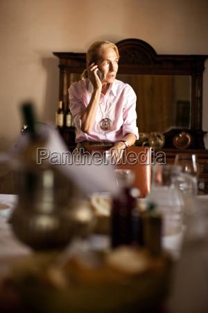 worried looking woman talking on telephone