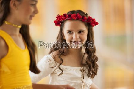 two smiling girls wearing ballet costumes