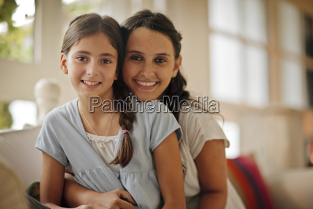 portrait of two sisters sitting on