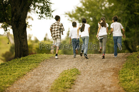 small group of children running together