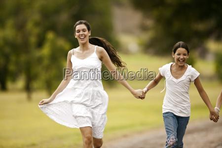 teenage girl walking hand in hand