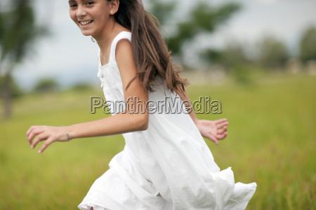 girl running over the field