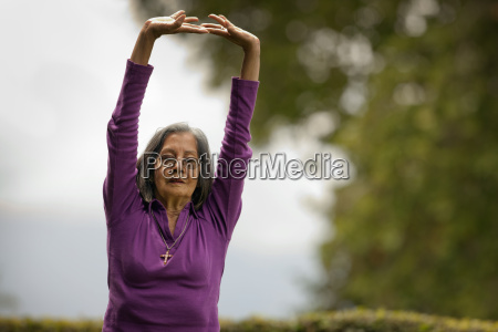 senior woman practicing yoga in her
