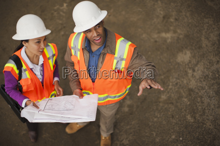 two colleagues discussing a project on