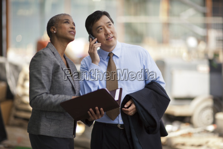 two business colleagues discussing plans for