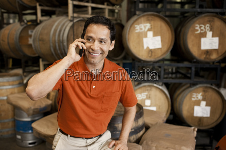 smiling mid adult man talking on