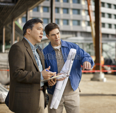business colleagues discussing plans at a