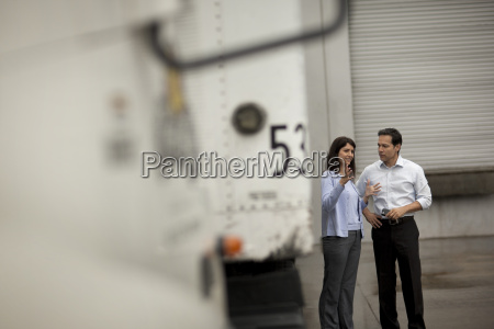 two business colleagues animatedly discussing work