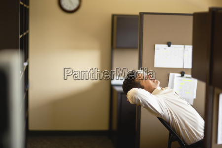 businessman taking time out lying back