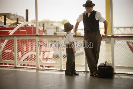 father and son on a ferry