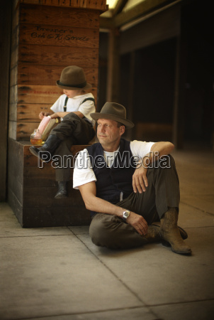 father and son at train depot