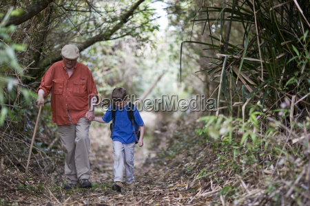grandfather and grandson holding hands while