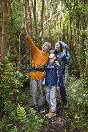 grandsons and grandmother exploring nature