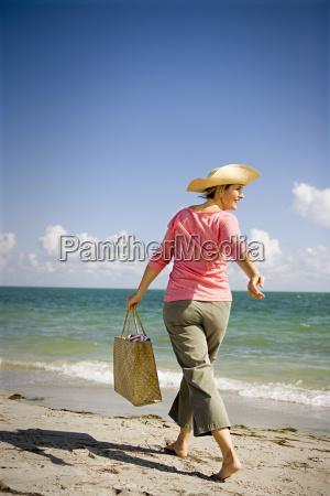 mature adult woman running along the