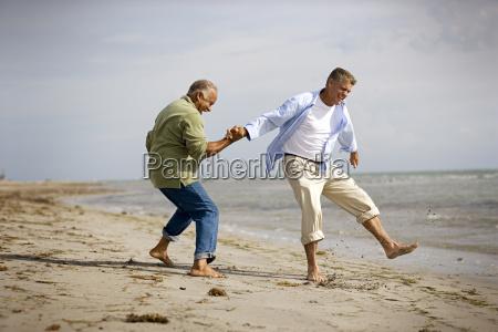 two mature men having fun together