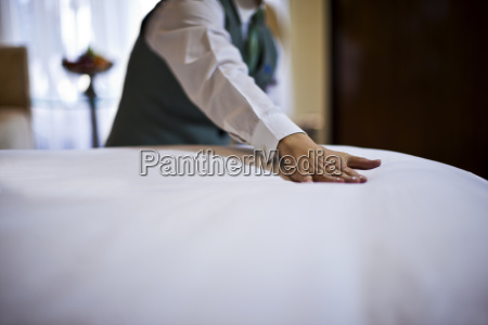 cruise ship staff member changing bed