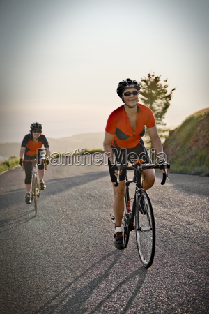smiling mid adult woman cycling in