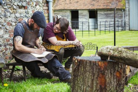 two blacksmiths a man and woman
