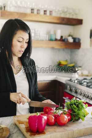 a woman using a sharp knife
