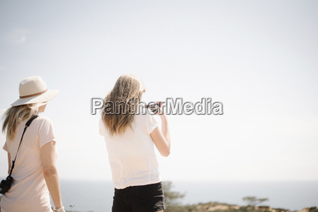 woman and teenage girl with long