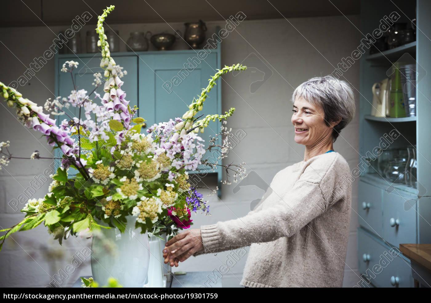 A Florist Working On A Tall Vase Arrangement Of Stock Photo 19301759 Panthermedia Stock Agency,Kitchen Garden Window Ideas