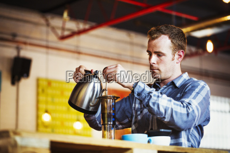 specialist coffee shop a man pouring
