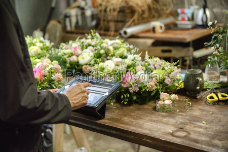 a woman in a florists workshop
