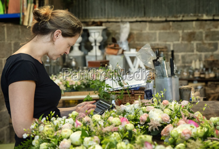 a florist working using a digital