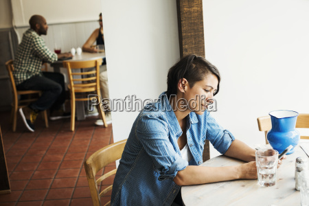 woman with short brown hair sitting