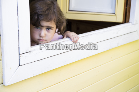 portrait of little girl looking through