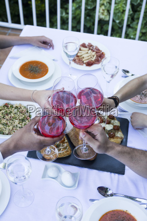 friends toasting with lambrusco wine during